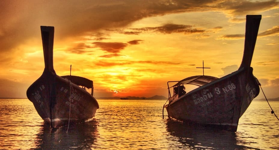 7 islands sunset by long tail boat