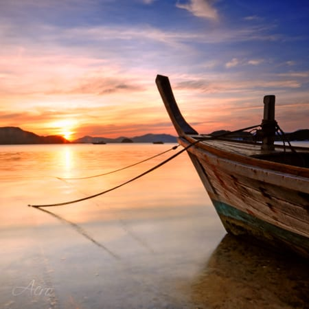 longtail boat sunset
